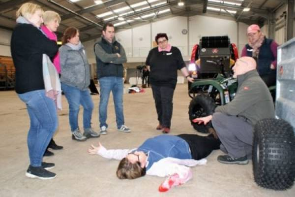 Farmers participating in a first aid course